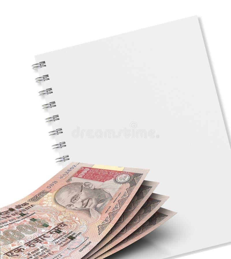 Cuaderno y dinero fotos de archivo