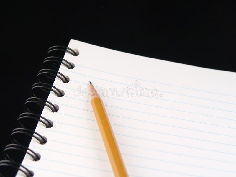 Cuaderno y lápiz foto de archivo libre de regalías