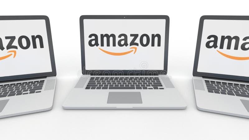 Cuadernos con el Amazonas logotipo de COM en la pantalla Representación conceptual del editorial 3D de la informática ilustración del vector