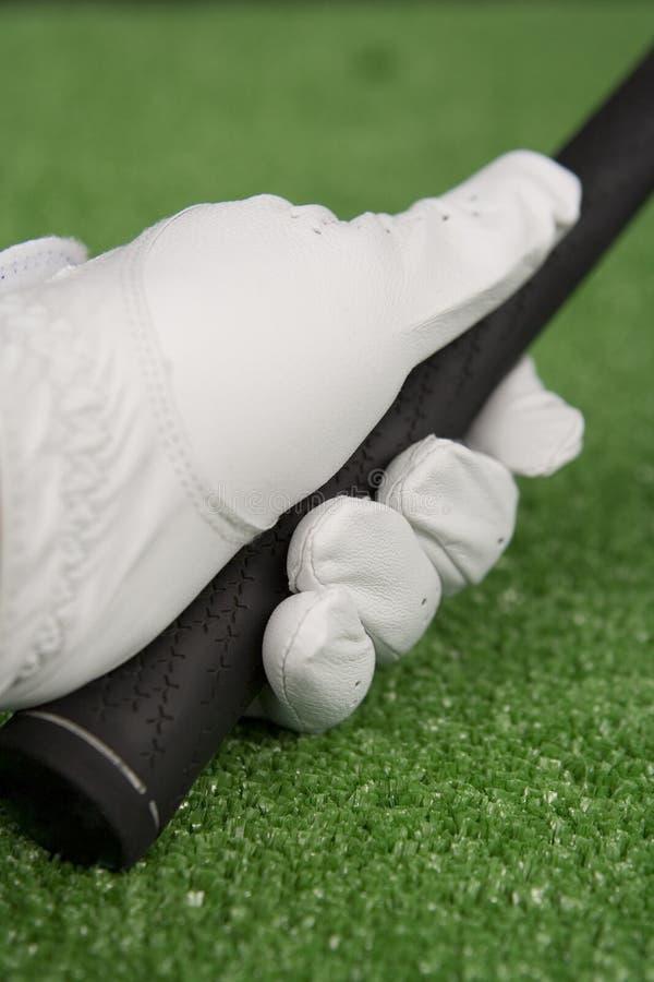 Cuadro de una mano con guantes del golf fotos de archivo