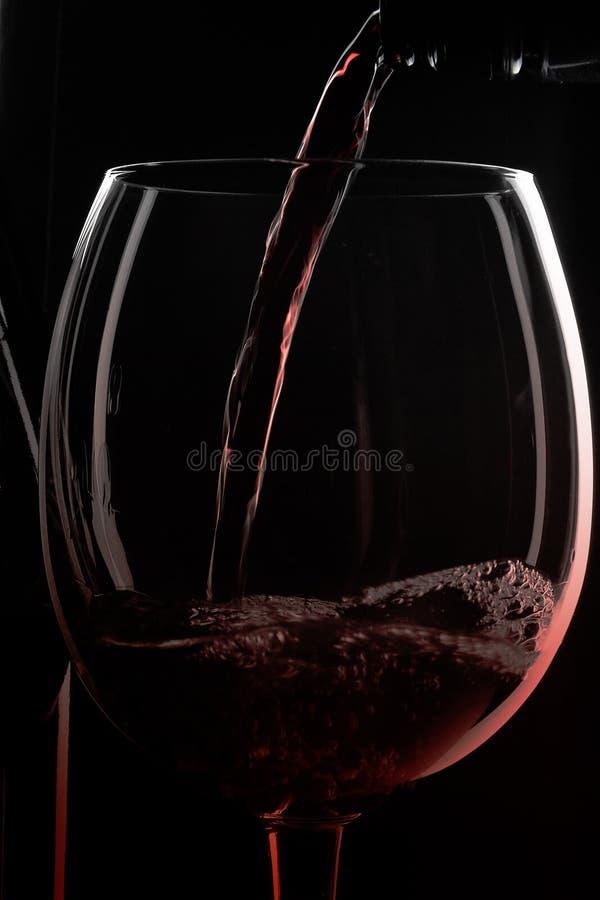 Cuadro llenado del vino rojo imagen de archivo