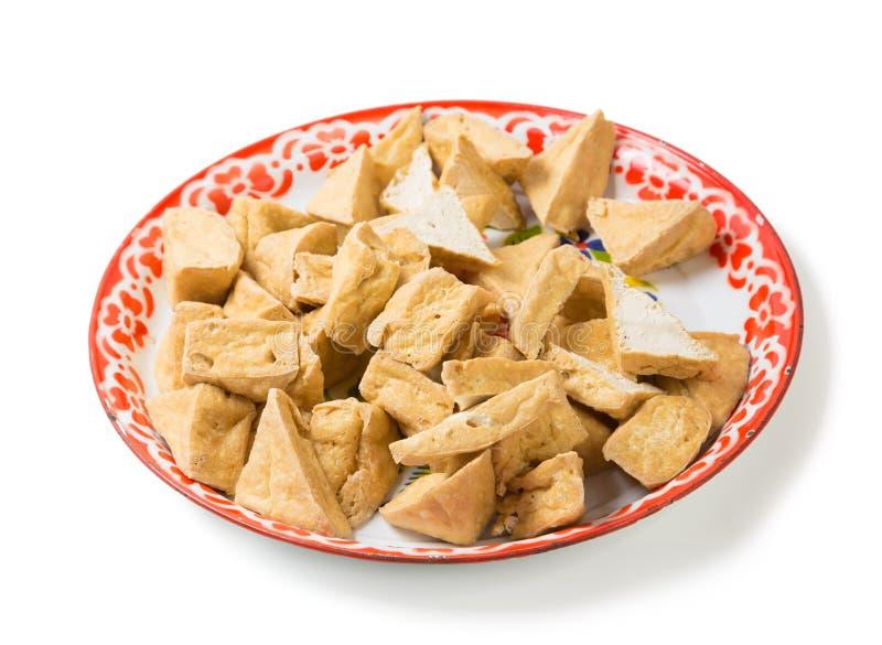 Cuajada frita del queso de soja o de habichuelas en el ingrediente tailandés tradicional de la bandeja para la comida foto de archivo