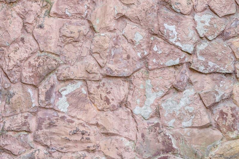 Cuarzo color de rosa de la vieja tonalidad de la pared de piedra fotos de archivo