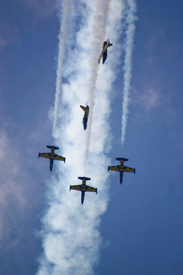 Cuatro aeroplanos durante la demostración de la aviación imágenes de archivo libres de regalías