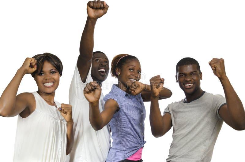 Cuatro amigos africanos en alegría imagenes de archivo