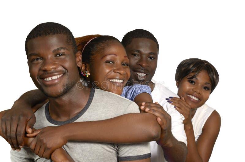 Cuatro amigos africanos en alegría imágenes de archivo libres de regalías