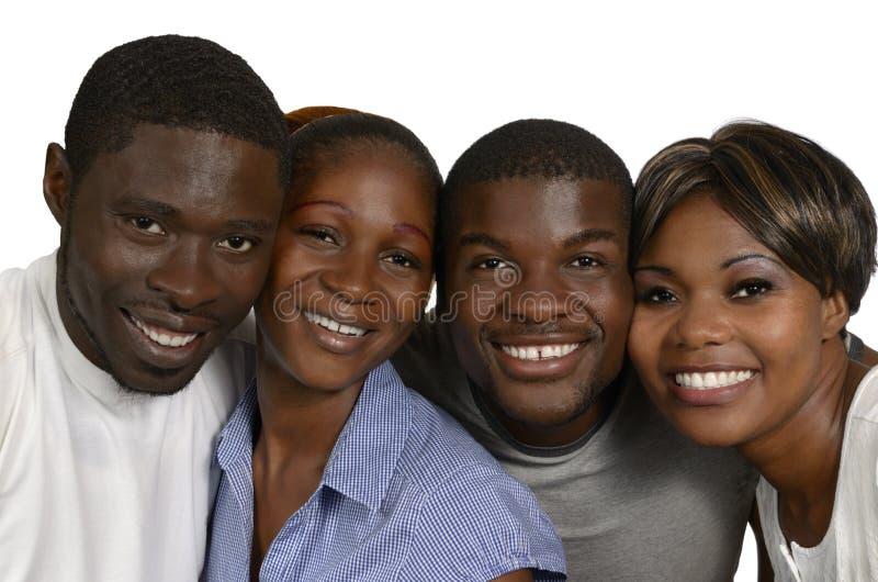 Cuatro amigos africanos en alegría imagen de archivo libre de regalías
