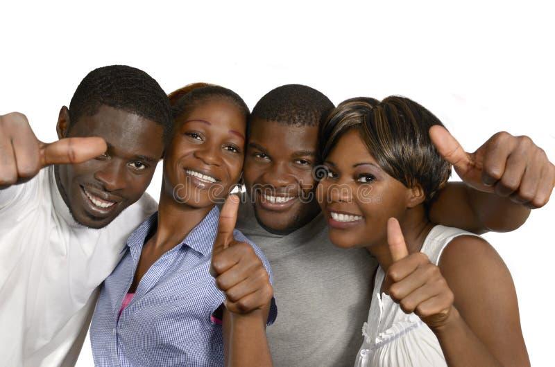 Cuatro amigos africanos que muestran los pulgares para arriba fotos de archivo libres de regalías