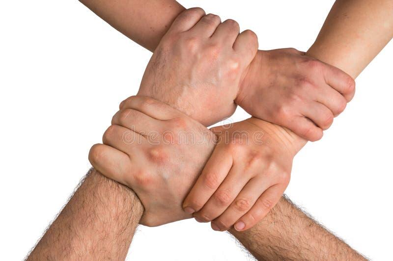 Cuatro brazos humanos cruzados y que se ligan imágenes de archivo libres de regalías