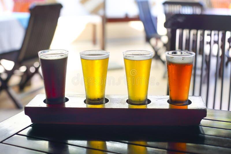 Cuatro clases de cerveza Prueba de la cerveza imagen de archivo libre de regalías