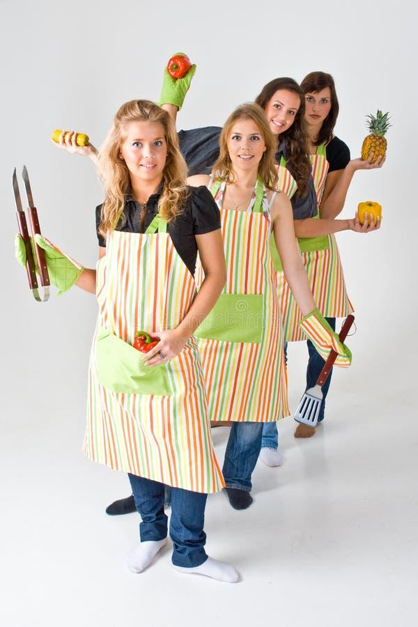 Cuatro cocineros de sexo femenino foto de archivo libre de regalías