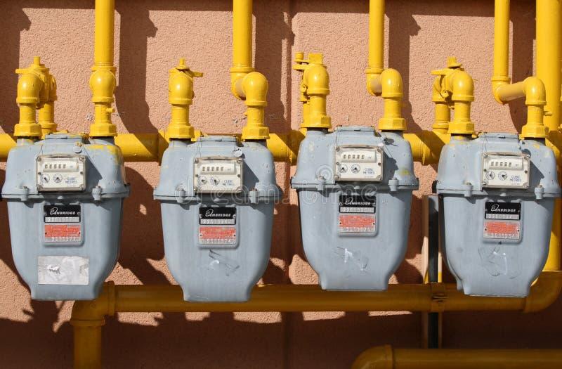 Cuatro contadores de gas fotos de archivo libres de regalías