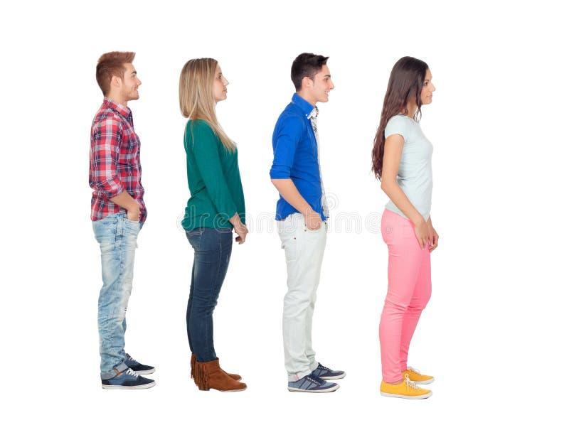 Cuatro grupos de personas casuales en fila fotografía de archivo