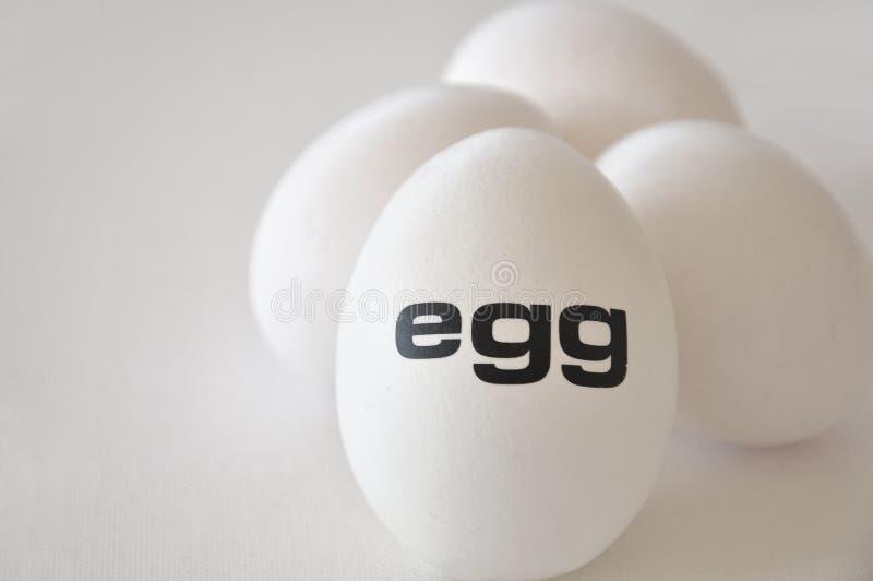 Cuatro huevos fotos de archivo