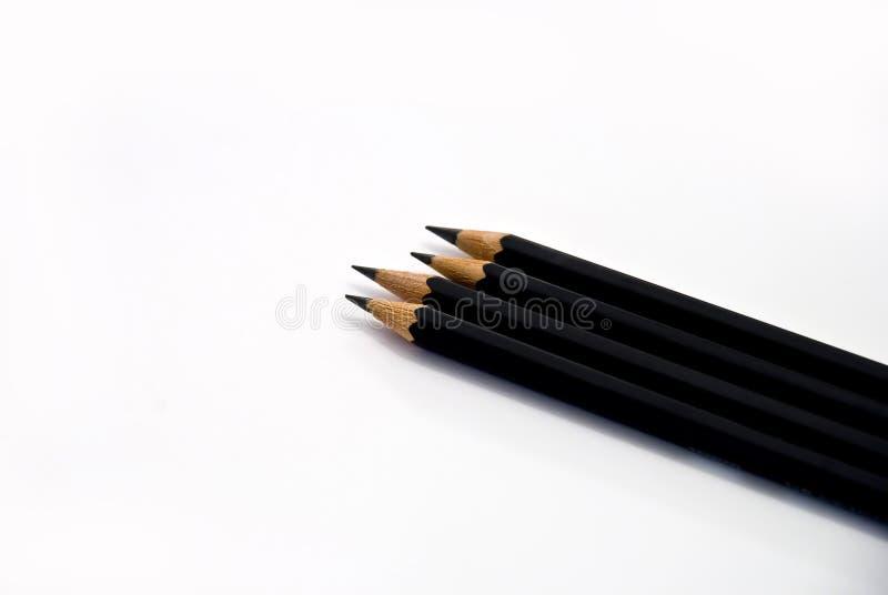 Cuatro lápices imagen de archivo libre de regalías