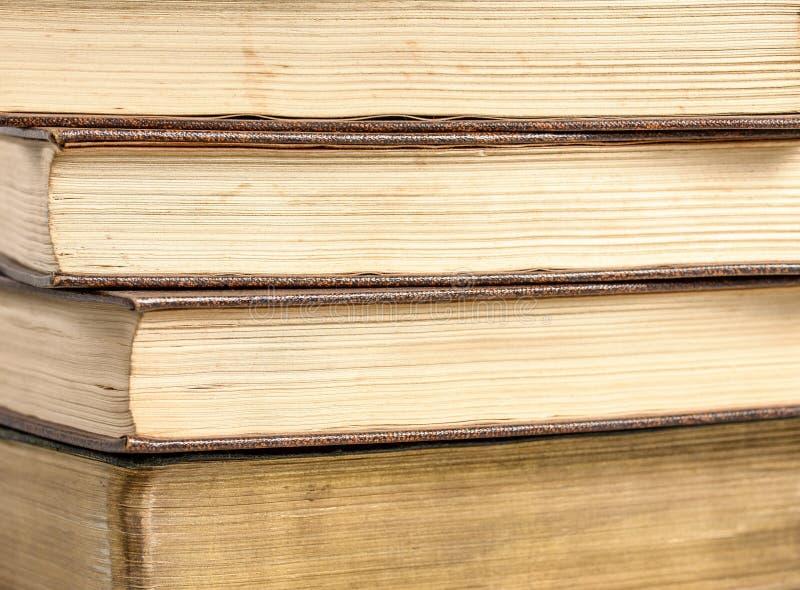 Cuatro libros antiguos imagenes de archivo
