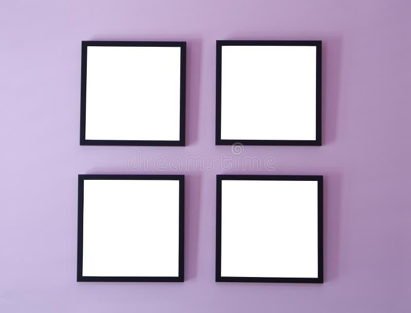 Cuatro marcos en la pared imágenes de archivo libres de regalías