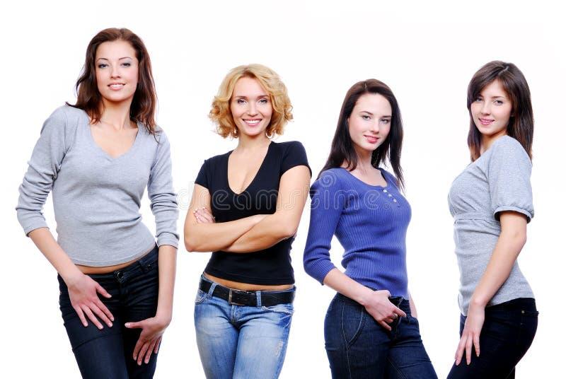 Cuatro muchachas felices jovenes atractivas fotografía de archivo libre de regalías