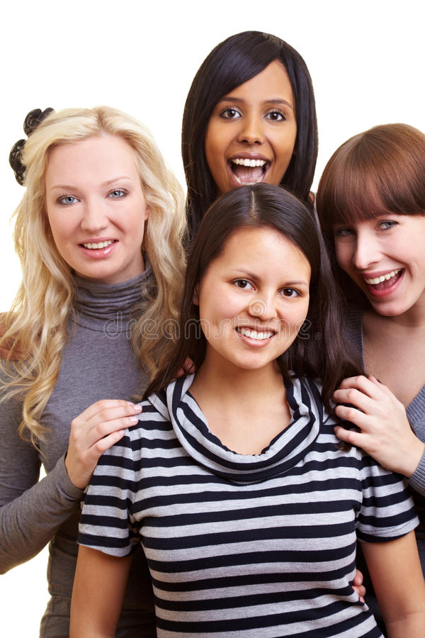 Cuatro mujeres que sonríen junto fotos de archivo libres de regalías