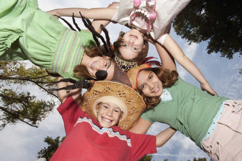 Cuatro niños felices en grupo fotografía de archivo libre de regalías