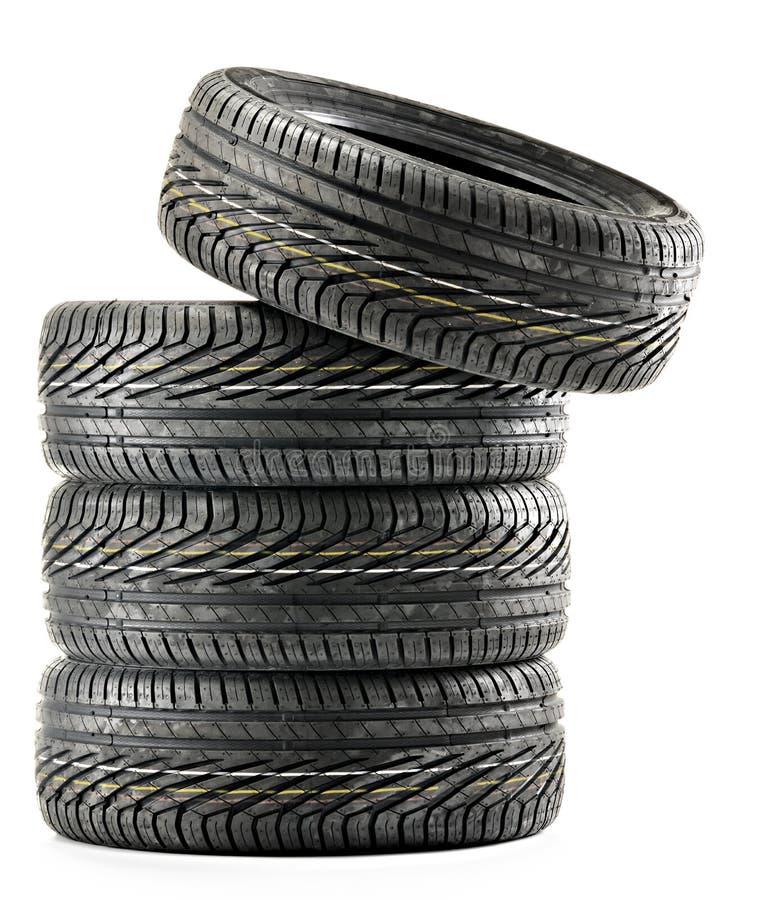 Cuatro nuevos neumáticos negros en blanco imagen de archivo