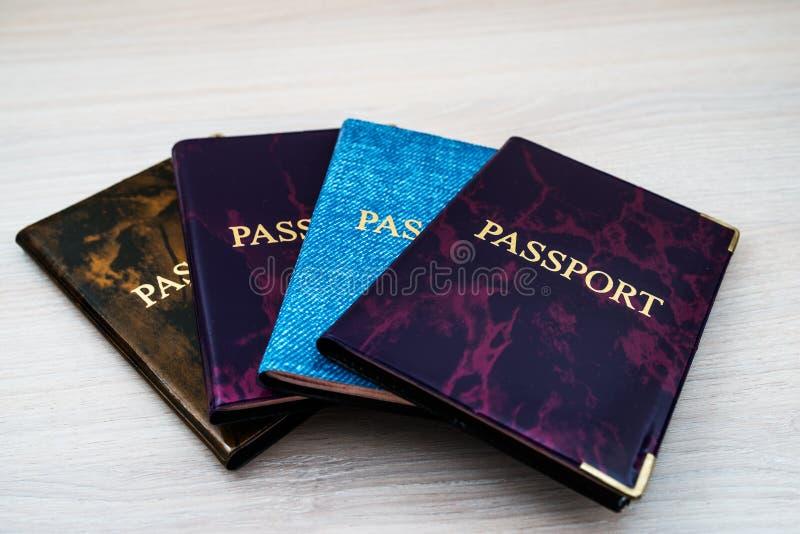 Cuatro pasaportes fotografía de archivo libre de regalías