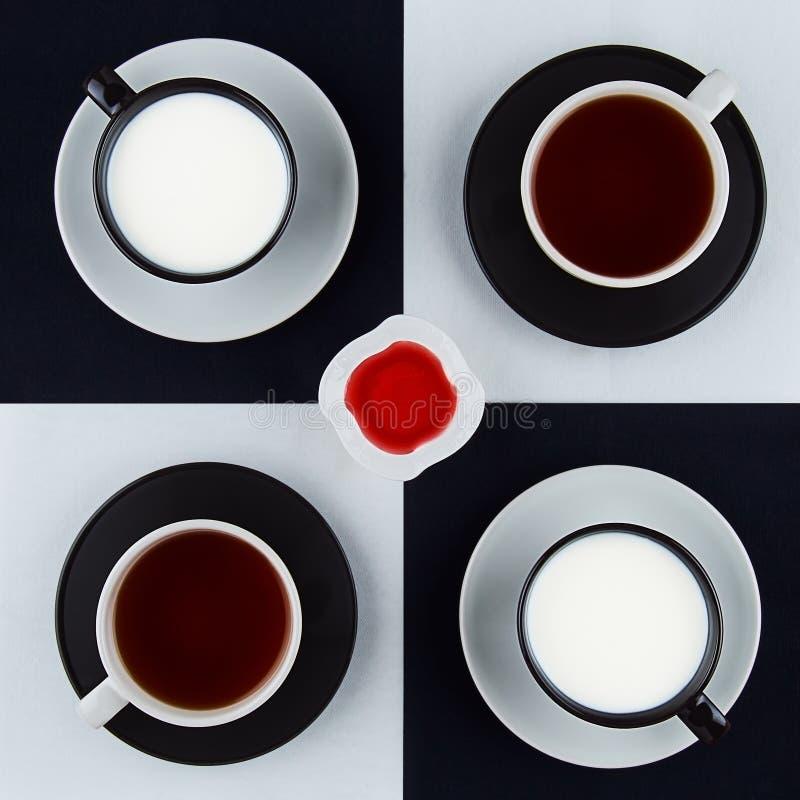 Cuatro tazas de bebidas, de cuadrado permanente y de atasco de frambuesa fotografía de archivo libre de regalías
