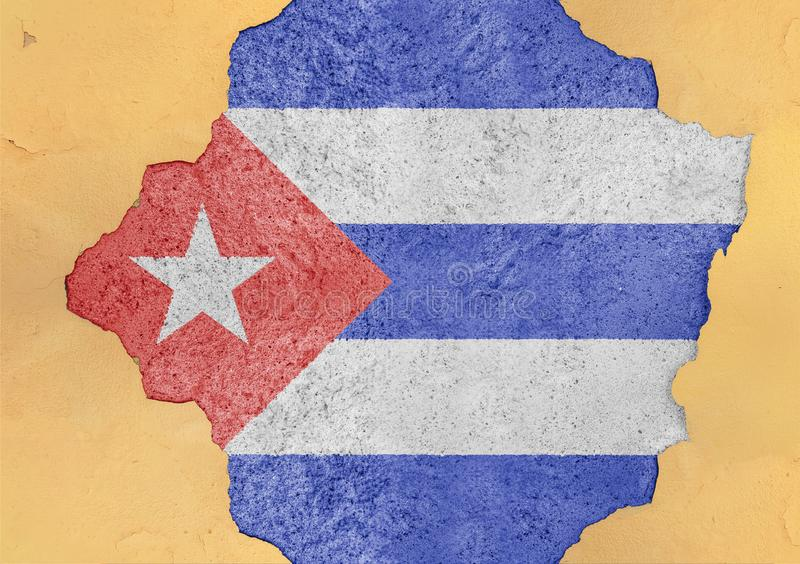 Cuba cracked hole and broken flag in big concrete material facade. Structure royalty free stock photography