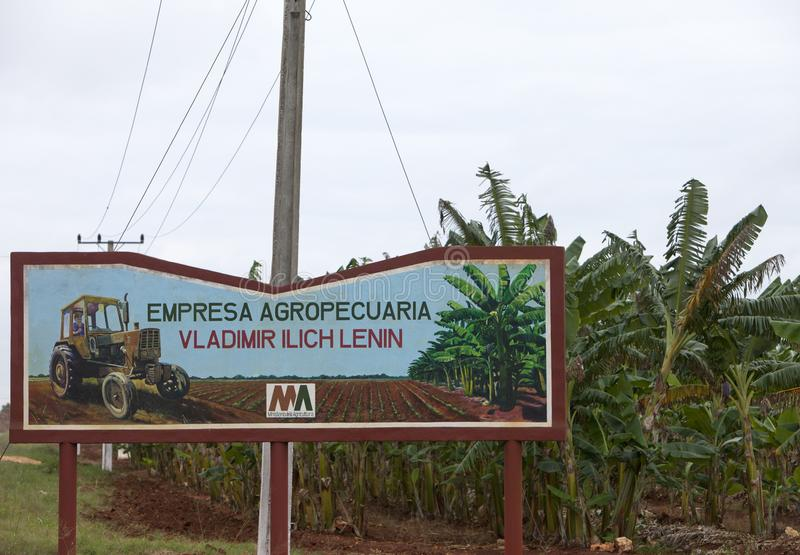 CUBA- FEBRUARY 02, 2013: A poster at the road - the Lenin State Farm royalty free stock images