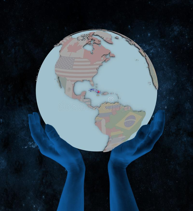 Cuba on political globe in hands royalty free stock images