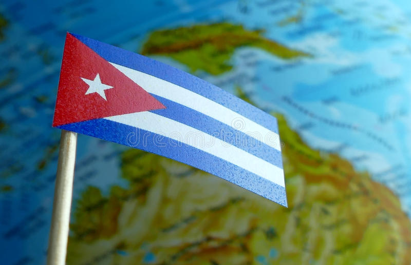 Cuba flag with a globe map as a background royalty free stock photography