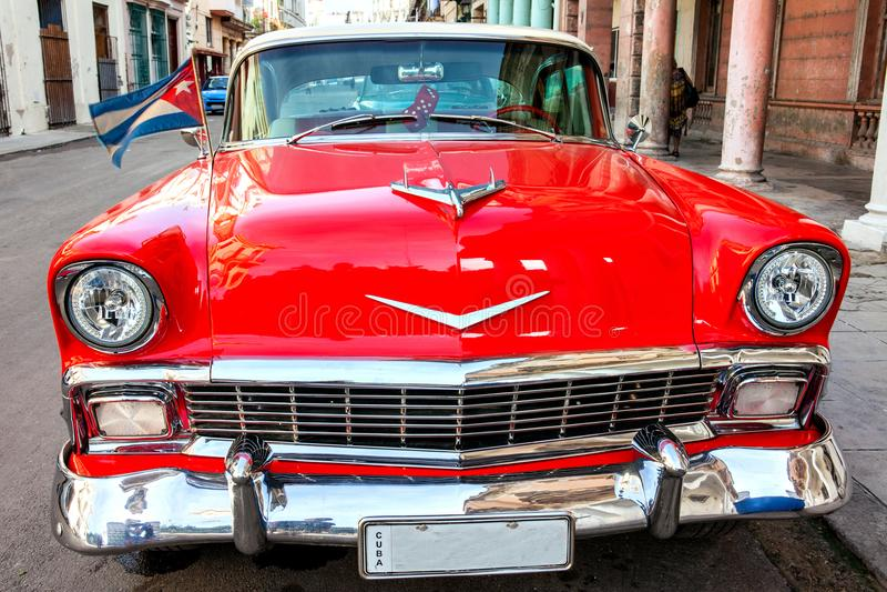 Cuba, Havana: American classic car with cuba flag parked on the stock photography