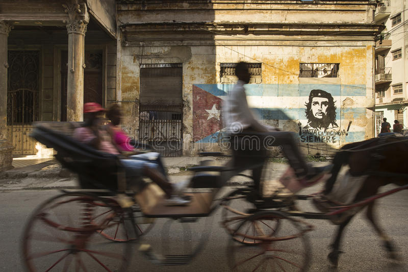 Cuba, Havana - 20 February 2017: Streets of Havana with graffitti on walls and local transportation in motion. Editorial picture. stock photography