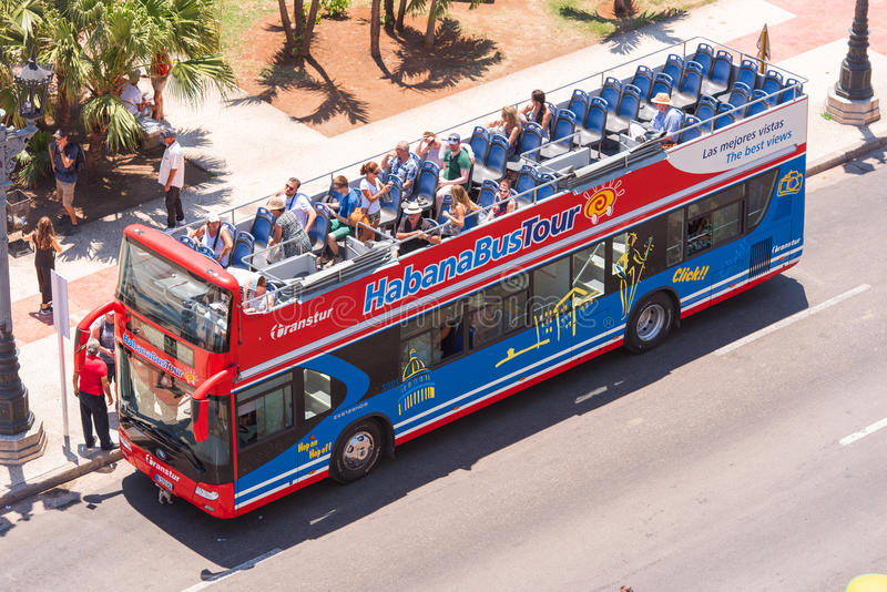 CUBA, HAVANA - MAY 5, 2017: Tourist bus with an open roof. Top view. Copy space for text. Top view. CUBA, HAVANA - MAY 5, 2017: Tourist bus with an open roof stock photos