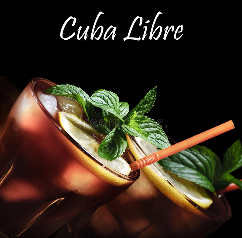 Cuba Libre. Cocktail on rustic wooden background royalty free stock photo