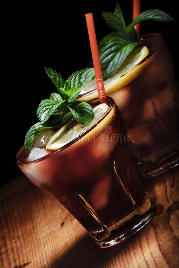 Cuba Libre. Cocktail on rustic wooden background stock photography