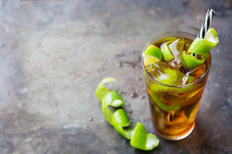 Cuba libre alcohol cocktail drink with rum, cola, ice, lime royalty free stock image
