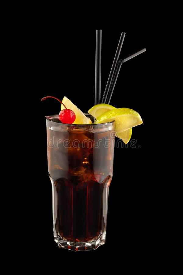 Cuba Libre cocktail. On a black background royalty free stock image