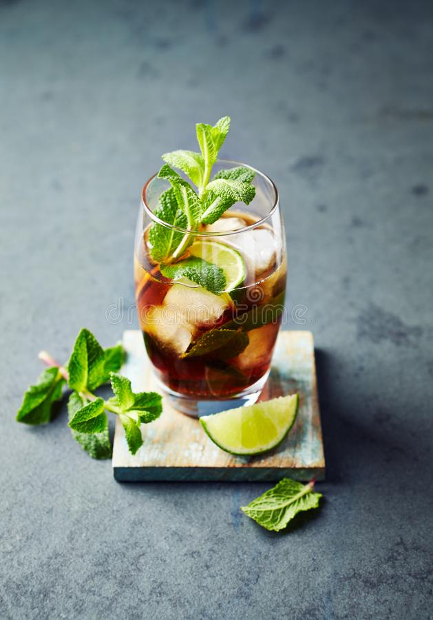 Cuba Libre in a Glass  rum with cola, lime, mint leaves and ice royalty free stock photo