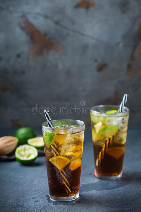 Cuba libre or long island iced tea alcohol cocktail drink. Food and drink, holidays party concept. Cuba libre or long island iced tea alcohol cocktail drink royalty free stock photos