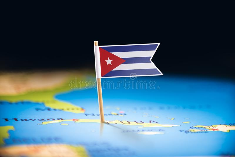 Cuba marked with a flag on the map.  royalty free stock images