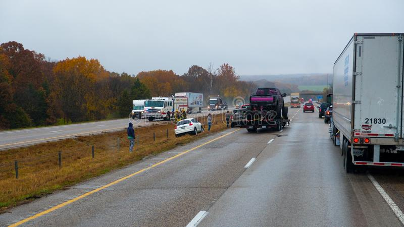 CUBA, MISSOURI - NOVEMBER 5, 2018 - Traffic accident on interstate 44 on a rainy day with police and fire department on site. Picture taken thru windshield royalty free stock images