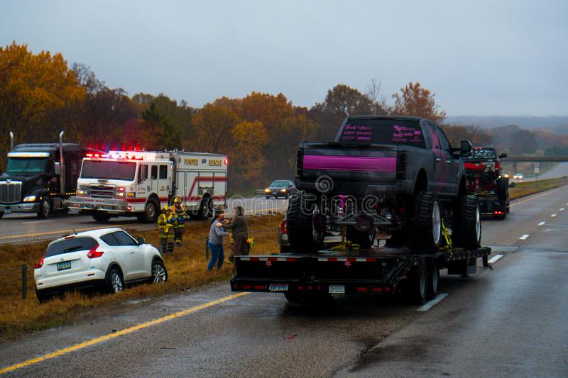 CUBA, MISSOURI - NOVEMBER 5, 2018 - Traffic accident on interstate 44 on a rainy day with police and fire department on site. Picture taken thru windshield stock image
