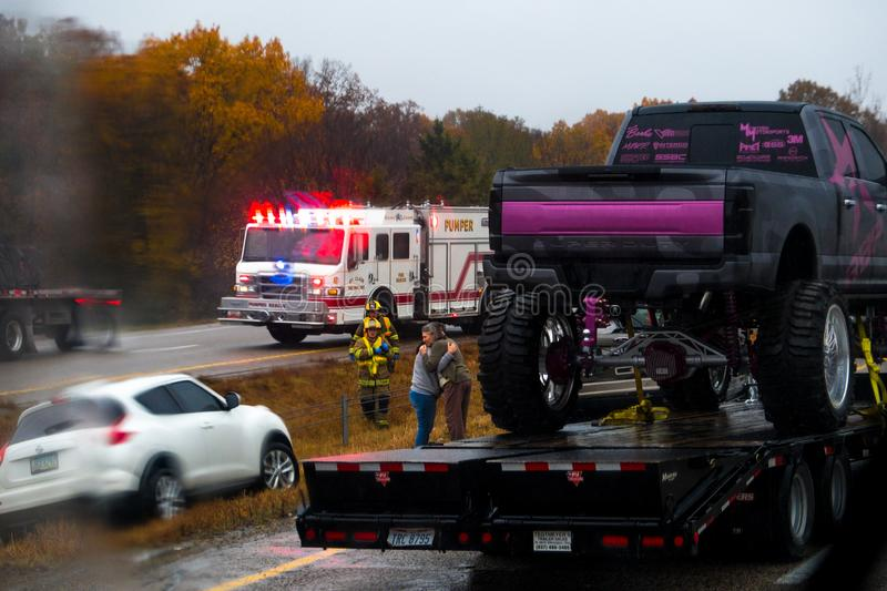 CUBA, MISSOURI - NOVEMBER 5, 2018 - Traffic accident on interstate 44 on a rainy day with police and fire department on site. Picture taken thru windshield royalty free stock photos