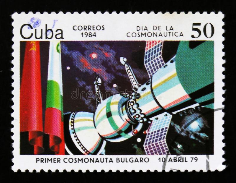 Cuba postage stamp shows Premier Bolgarian satellite in space, 1979, and flags, circa 1984 royalty free stock photo
