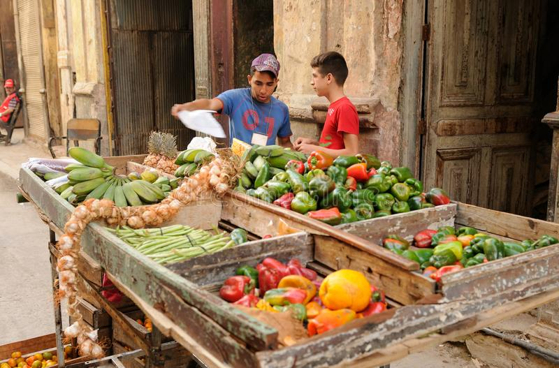Cuba: Young street-market-traders in Havanna-City. royalty free stock images