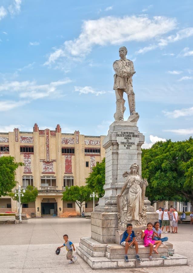 Cuban children at monument of Calixto Garcia Iniguez stock photo