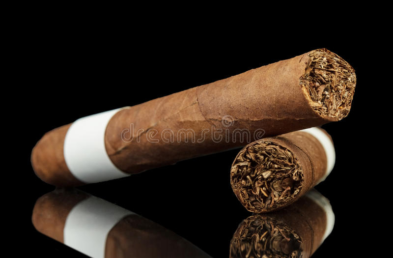 Cuban cigars. With reflection on black background stock images