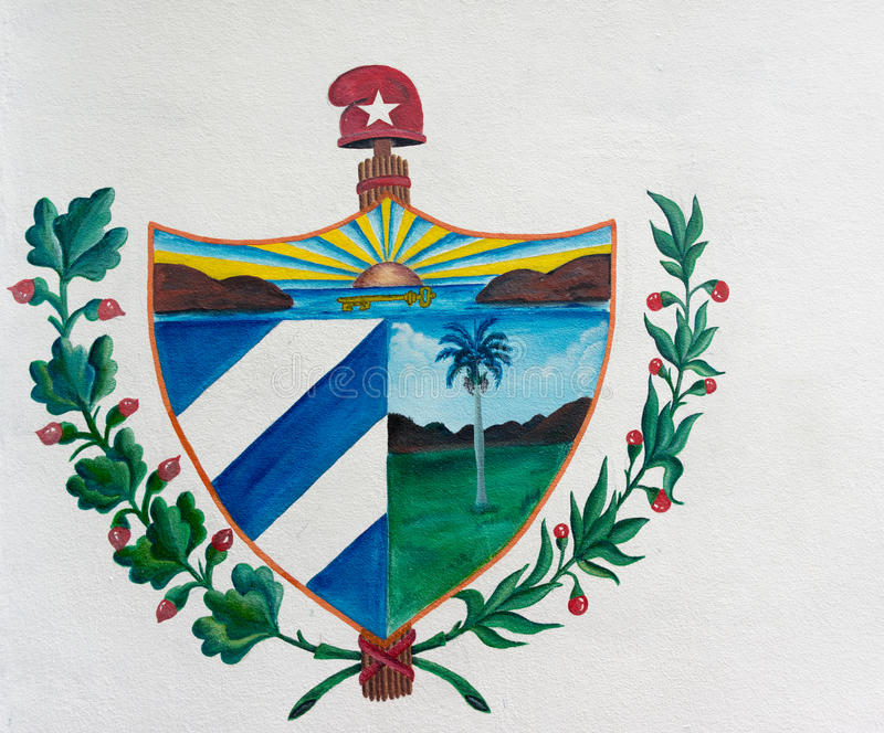 Cuban Coat of Arms Painted on Street Wall. Cuba or Cuban coat of arms painted on a white wall, creative and beautiful drawing of the symbol Shield of Cuba in a stock images