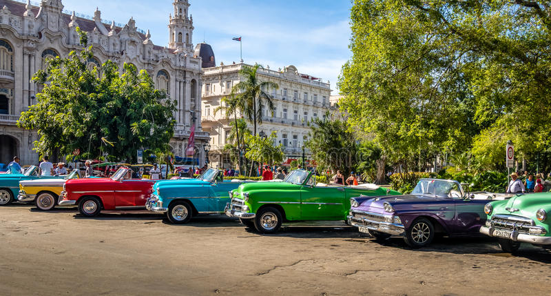 Cuban colorful vintage cars in front of the Gran Teatro - Havana, Cuba. HAVANA, CUBA - Oct 7, 2016: Cuban colorful vintage cars in front of the Gran Teatro royalty free stock photos